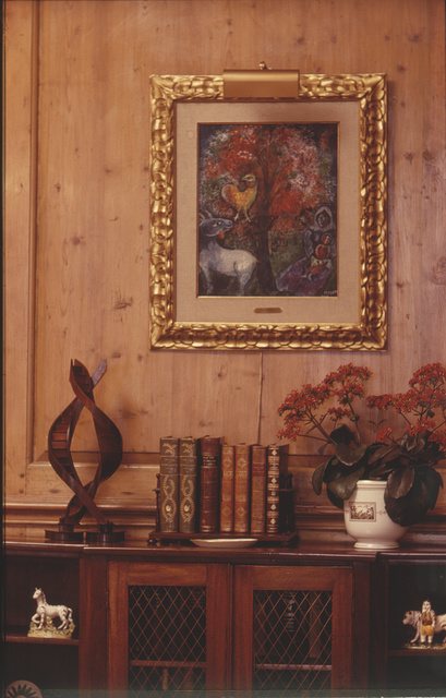 [Marc Chagall painting on wall over a cabinet with flower arrangement, at Ann BonfoeyTaylor's home, Denver, Colorado]