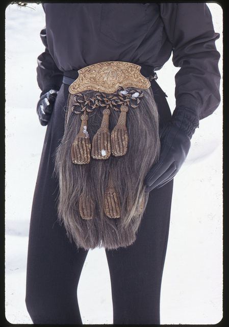 [Ann Bonfoey Taylor wearing black with a Scottish sporran (purse) around her waist as part of a ski outfit, Colorado]