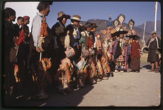 [Black Hat Lama and men with offerings at New Year's ceremony, Sikkim]