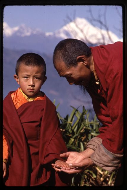 Holiest reincarnate in Sikkim with teacher, Mt. Khangchondzonga [in] background