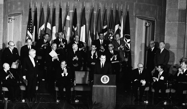[President Richard Nixon addressing audience at NATO's 20th anniversary meeting, State Department Interdepartmental Auditorium, Washington, D.C.]
