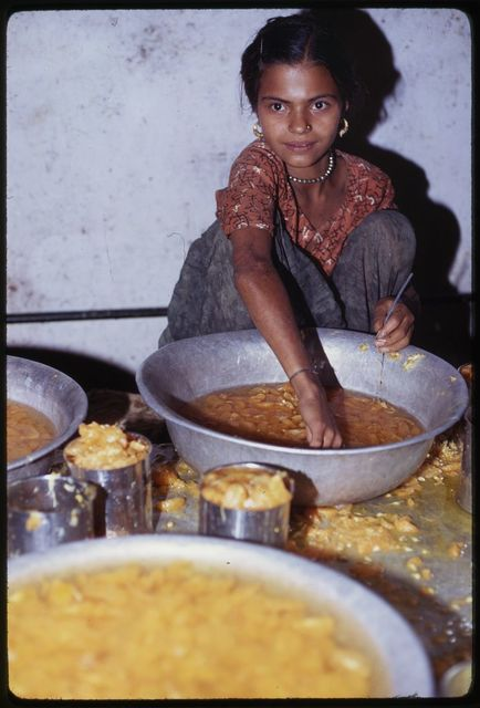 [Young girl canning oranges, Sikkim]