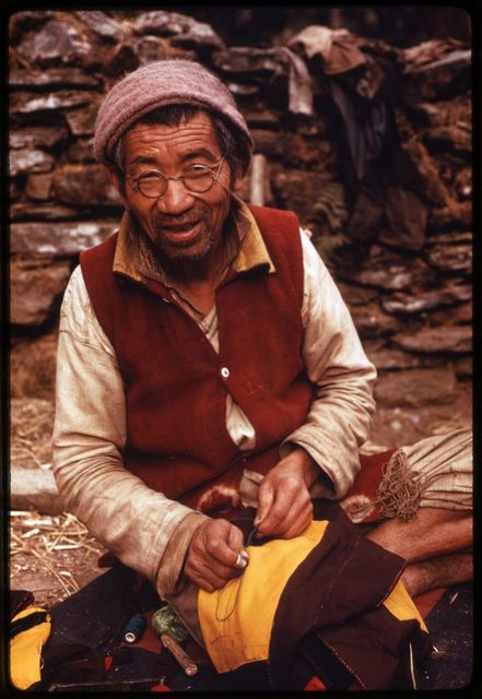 [Bhotia tailor sewing a vest at Geyzing (Gyalshing) Government Farm in western Sikkim]