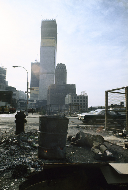 View of the World Trade Center under construction from Duane Street, Manhattan, 1970.  The homeless man in this image woke up as he was being photographed and asked Vergara to buy him a ham sandwich.