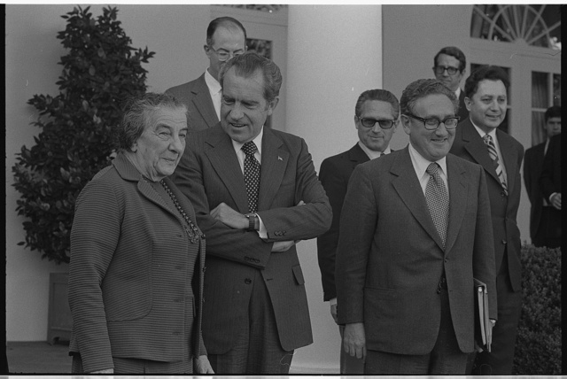 [Israeli Prime Minister Golda Meir standing with president Richard Nixon and Henry Kissinger, outside the White House]
