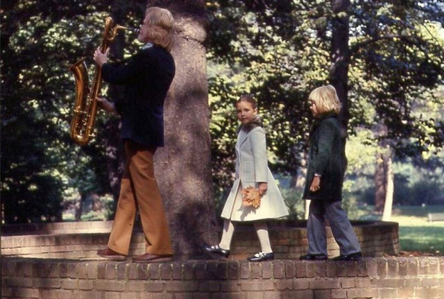 [ Gerry Mulligan, playing saxophone, with children]