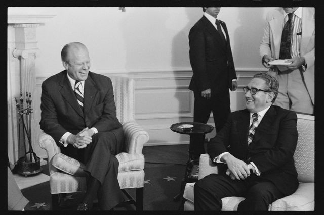 [President Gerald Ford and Secretary of State Henry Kissinger, seated, in the Roosevelt Room of the White House, Washington, D.C.]
