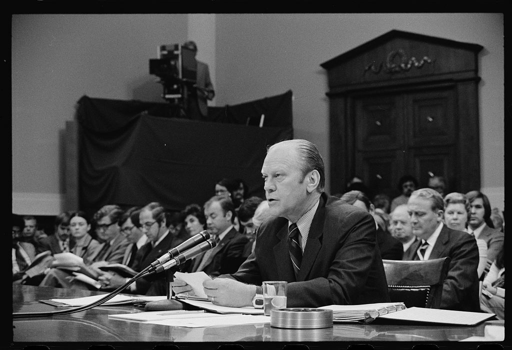 [President Gerald Ford appearing at the House Judiciary Subcommittee hearing on pardoning former President Richard Nixon, Washington, D.C.]