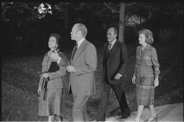 [President Gerald Ford walking with Egyptian President Anwar Sadat, Sadat's wife Jihan and Betty Ford, during the Sadat's visit to the United States]