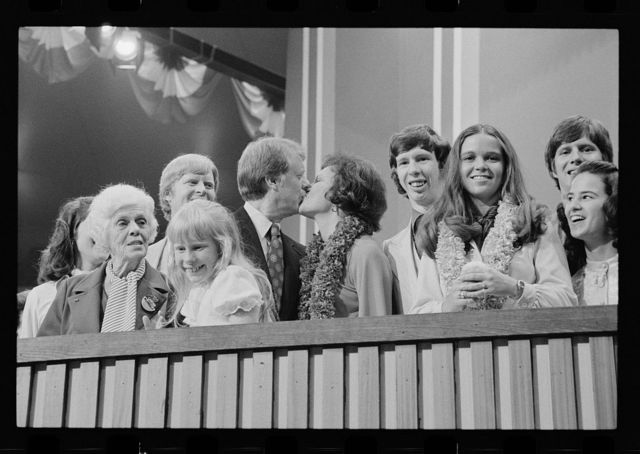 [Jimmy and Rosalynn Carter kissing, surrounded by family, including Amy and Lillian, at the Democratic National Convention, New York City]