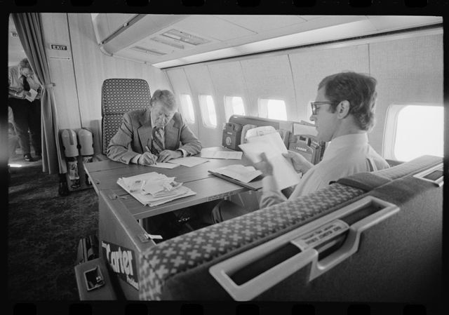 "[Jimmy Carter and his chief speechwriter, Pat Anderson, working aboard the ""Peanut One"" campaign airplane]"