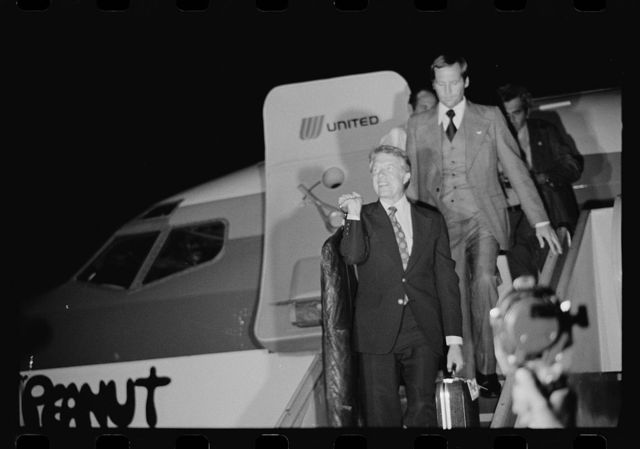 "[Jimmy Carter disembarking from the airplane ""Peanut One"" at the Wilkes-Barre Scranton Airport for a campaign stop in Pennsylvania]"