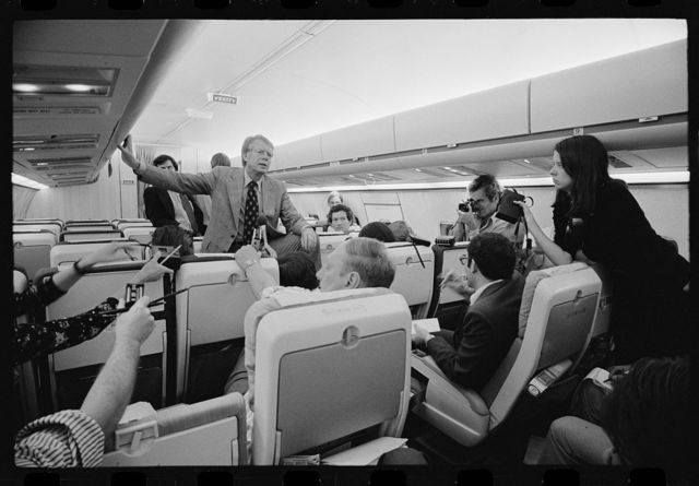 [Jimmy Carter holding an informal press conference aboard his plane on a campaign trip]
