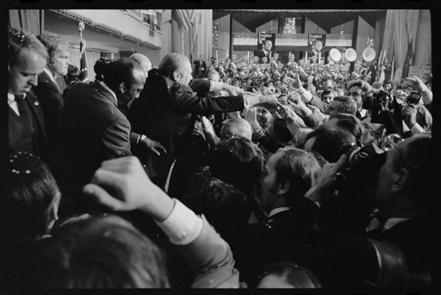 [President Gerald Ford shakes hands with supporters at the 1st presidential debate with Jimmy Carter in Philadelphia, Pennsylvania]