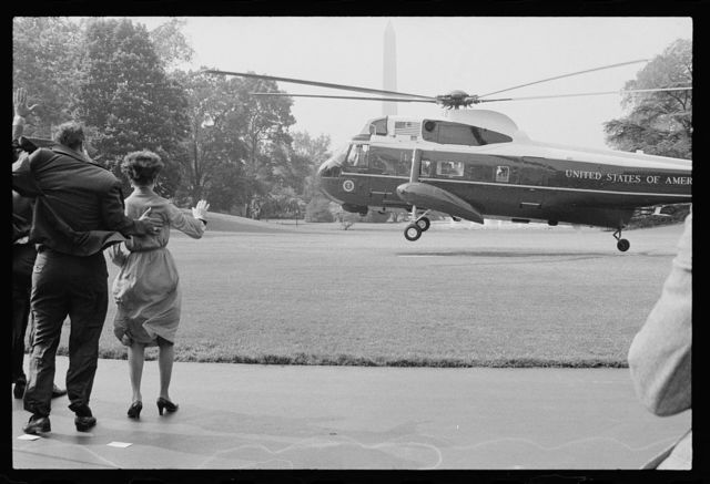 [Helicopter takes off from the White House lawn as First Lady Rosalynn Carter and unidentified men wave goodbye to President Jimmy Carter, Washington, D.C.]