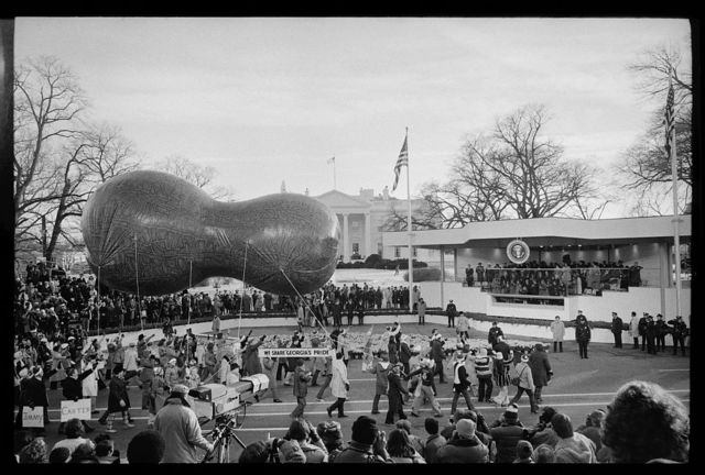 [Peanut-shaped float passes by reviewing stand for the inauguration of Jimmy Carter to President, Washington, D.C.]