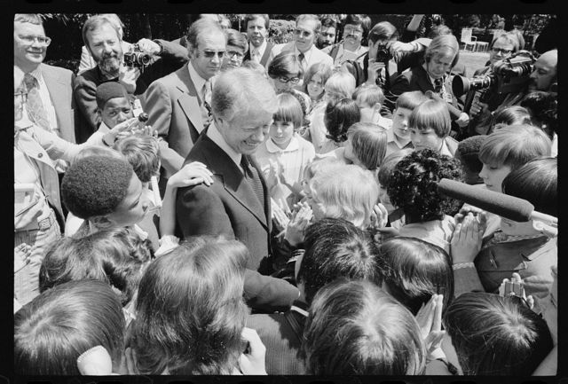 [President Jimmy Carter surrounded by school children in North Carolina]