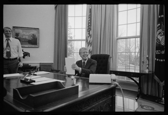 [President Jimmy Carter working on a speech for television in the Oval Office of the White House, Washington, D.C.]
