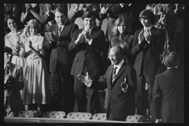 [Egyptian President Anwar Sadat acknowledges applause during a Joint Session of Congress in which President Jimmy Carter announced the results of the Camp David Accords]