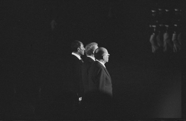 [President Jimmy Carter, Egyptian President Anwar Sadat, and Israeli Prime Minister Menachem Begin reviewing Marines during Camp David Accords.]