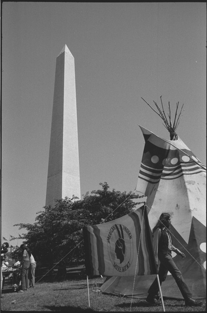 """[Tipi with sign """"American Indian Movement"""" on the grounds of the Washington Monument, Washington, D.C., during the """"Longest walk""""]"""