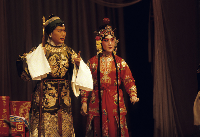 [Actors in the roles of a grandmother and another woman in the Peking Opera]