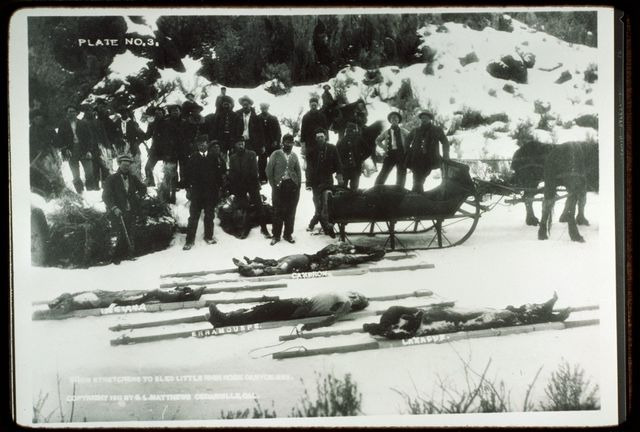 Bodies as Brought out of Back Country following Indian Massacre, ca. 1911