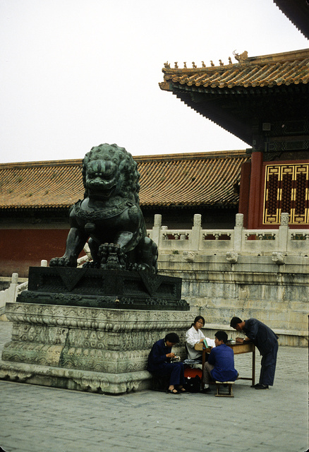 [Bronze lion statue at the Gate of Supreme Harmony in the Forbidden City, Beijing, China]