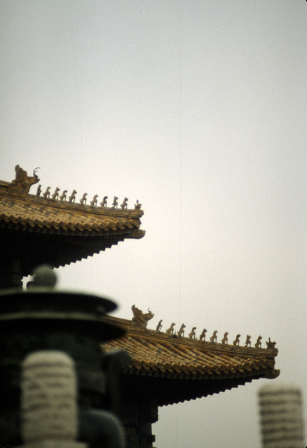 [Detail showing mythical figurines on the roof of the Hall of Supreme Harmony at the Imperial Palace Museum, in the Forbidden City, Beijing, China]