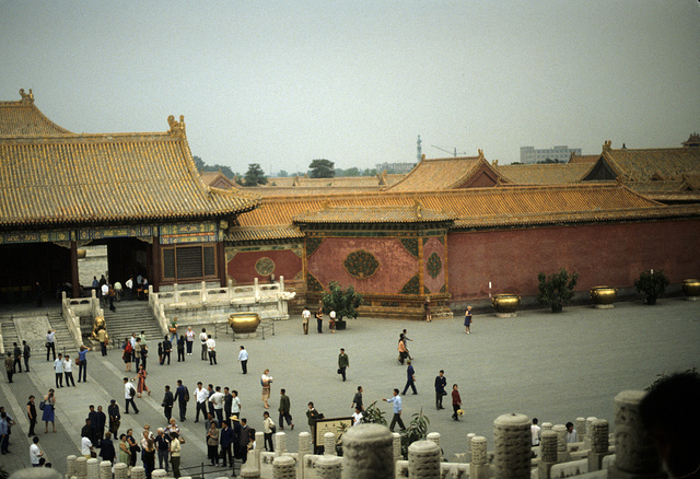 [Gate at the entrance to the inner court, or family residence area, in the Forbidden City, Beijing, China, with tourists in a plaza in the foreground]