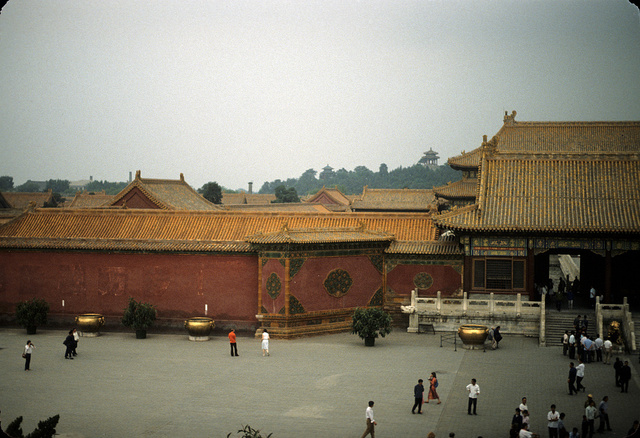 [Gate at the entrance to the inner court, or family residence area, in the Forbidden City, Beijing, China, with tourists in foreground]