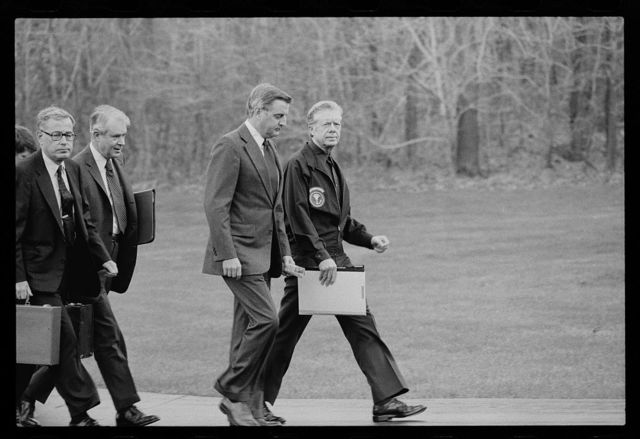 [President Jimmy Carter, Vice President Walter Mondale, Secretary of State Cyrus Vance, and Secretary of Defense Harold Brown after disembarking from their helicopter to meet about the Iran Hostage Crisis at Camp David, Maryland]