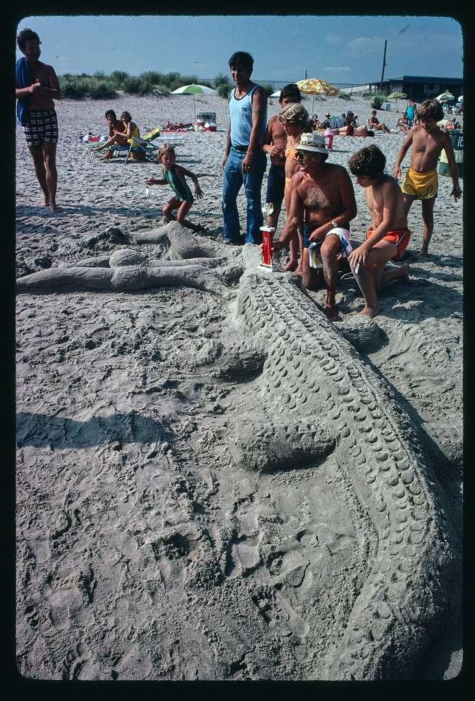 Sand sculpture contest entries, winner, boys playing, destroying sculptures, Canonchet Beach, Rhode Island