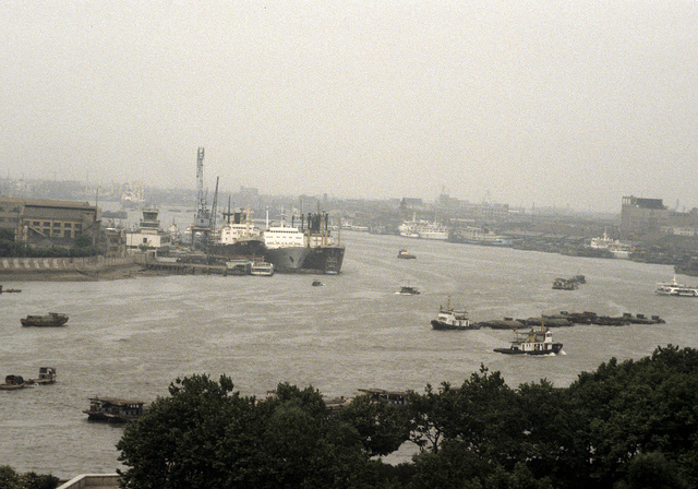 [Tugboats and cargo ships on the Huangpu River in Shanghai, China]