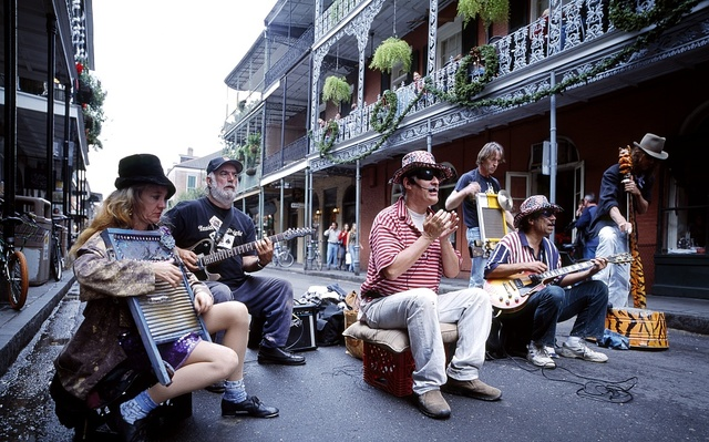 A street band has no competition, from other musicians or automobiles, on Bourbon Street in the French Quarter of New Orleans, Louisiana