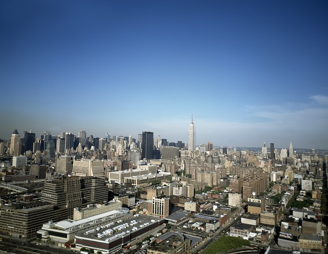 Aerial view of midtown Manhattan, in which the Empire State Building dominates. New York, New York