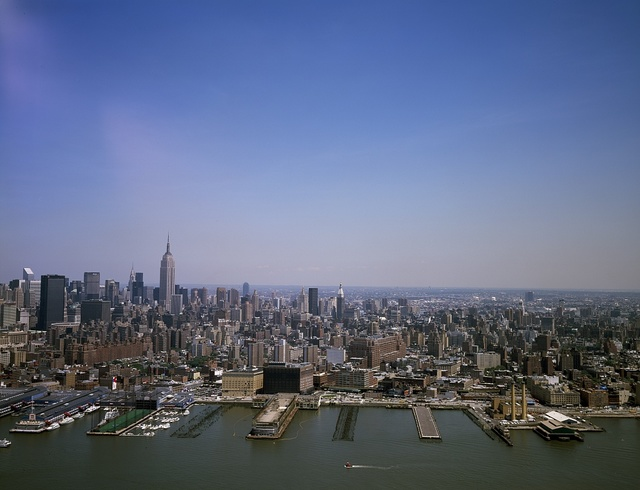 Aerial view of New York City from the East River. The Empire State Building is prominent on the skyline