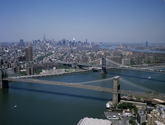 Aerial view of New York City, looking toward Brooklyn. The Brooklyn Bridge (below) and Manhattan Bridge are shown crossing the East River