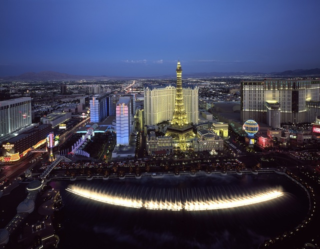 "Aerial view showing the famous Las Vegas Strip and looking down upon the Bellagio Hotel and Resort's ""dancing waters"" fountain show, Las Vegas, Nevada"