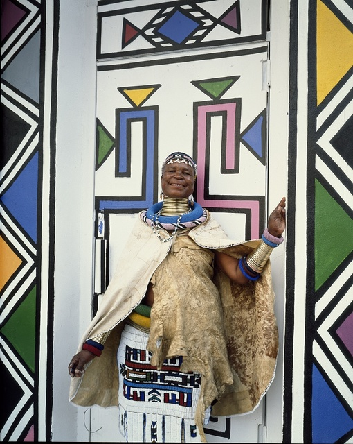 Artist from South Africa poses against her art at the National Museum of Women in the Arts in Washington, D.C.