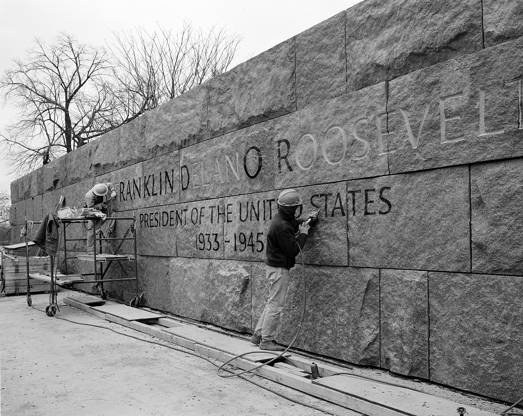 Carving stone at the FDR Memorial during construction, Washington, D.C.