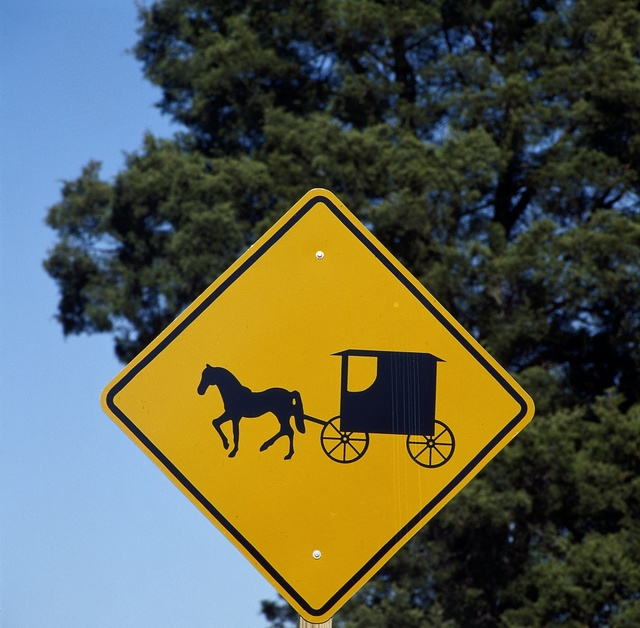 Caution sign to auto drivers to be on the lookout for Amish horses and buggies in Lancaster, Pennsylvania