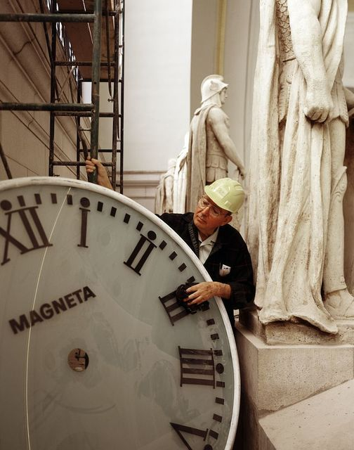Clock cleaner in historic Union Station in Washington, D.C.