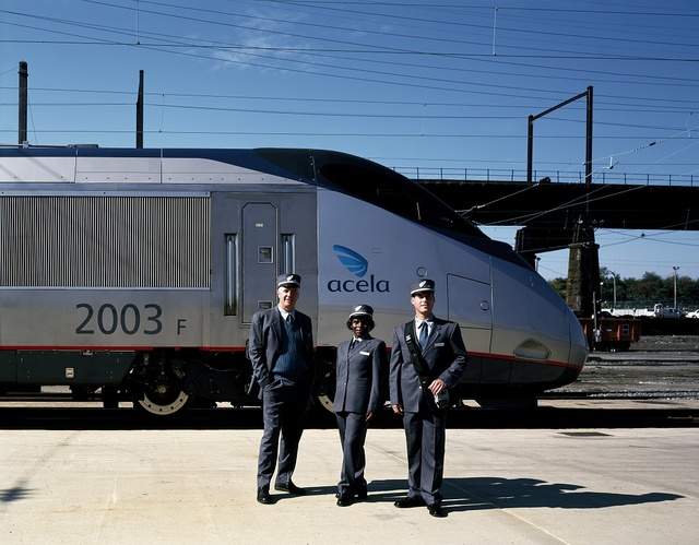 Crew of Amtrak's new Acela Express trainset model their new uniforms. Washington, D.C.