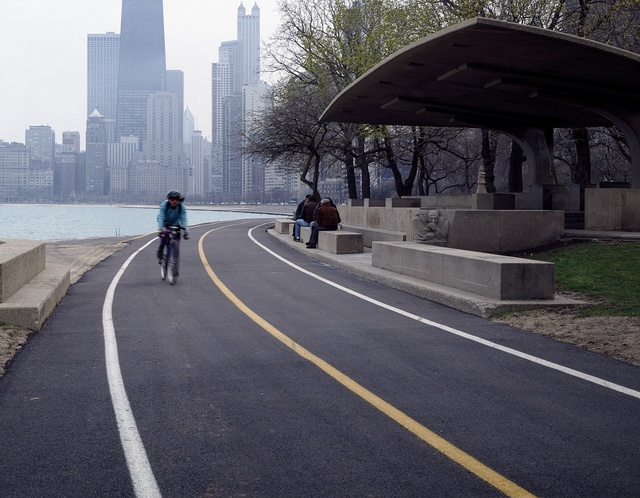 Cyclists, in-line skaters, and skateboarders regularly whiz past the Lincoln Park Chess Pavilion along the Lake Michigan shoreline, Chicago, Illinois