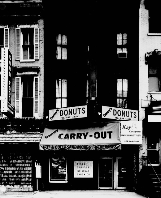 Danny's Donuts and other stores at 11th and E Streets, N.W., Washington, D.C., photographed before they were demolished to make way for new buildings