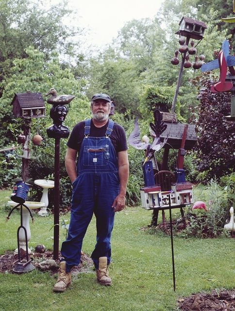 Folk artist Bennie Carter (1st cousin of photographer Carol M. Highsmith) amid some of his creations outside his home, Rockingham County, North Carolina