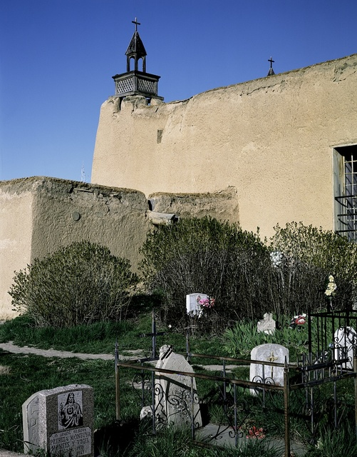 Humble graveyard behind the San Jose de Gracia adobe church, built by local farmers high in the Sangre de Cristo Mountains of New Mexico
