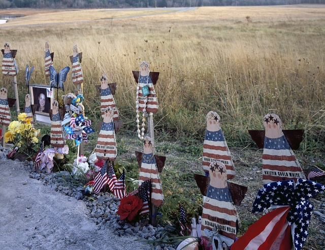 Informal tributes posted at the first, temporary memorial site in Shanksville, Pennsylvania, to those who perished on United Flight 93, which crashed during an attempt by passengers to recapture the plane, which had been hijacked by terrorists on 9/11/01