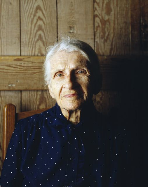 Kate Carter, on her 90th birthday, poses in the log cabins where photographer Carol M. Highsmith's great-grandfather, Pleasant Jiles Carter (1847-1931) and grandfather, Yancey Ligon Carter (1873-1947) were born and lived in Wentworth, North Carolina